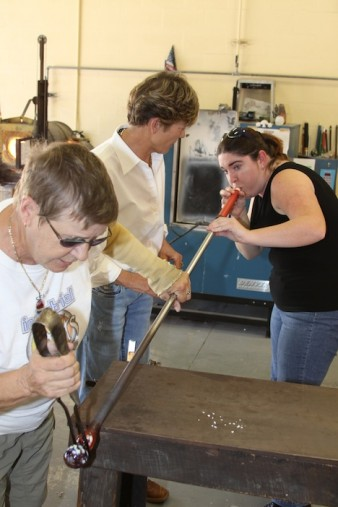 Blogger Ashley Grant blowing glass