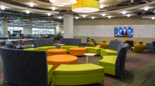 Brightly colored furniture in one of the sitting and gaming areas at new GoDaddy Global Technology Center in Arizona