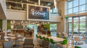 large cafeteria with massive flat-screen TV mounted on the wall at new GoDaddy Global Technology Center in Arizona