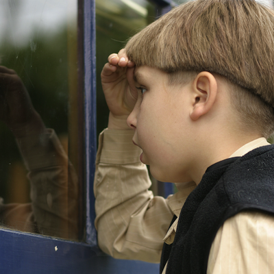 boy looking through storefront window