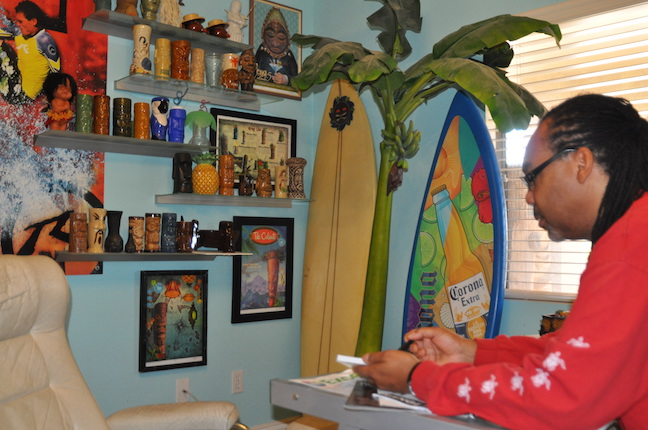Tiki Republic owner Pierre Mosley promotes his business online from his home office