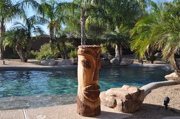Tiki beside sparkling pool