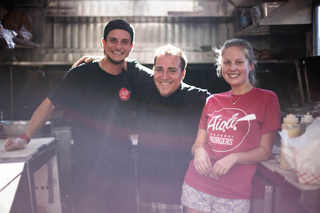"""We started off with the trucks to create proof of concept at a low cost and ease of entry into the market,"" says Chef Tommy D'Ambrosio (center), founder of Aioli Gourmet Burgers."