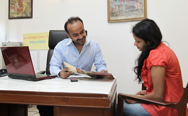 The Great Indian Adventure founder Pranav Chandra consults with a client.