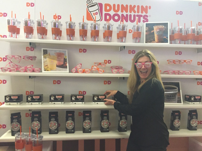 Woman wearing Dunkin Donuts glasses at the Dunkin Donuts booth at #BlogHer15