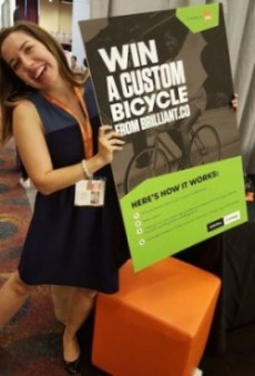 #blogher15 attendee holding GoDaddy bike giveaway sign