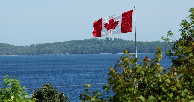 Canadian flag over lake to represent marketing to Canadians