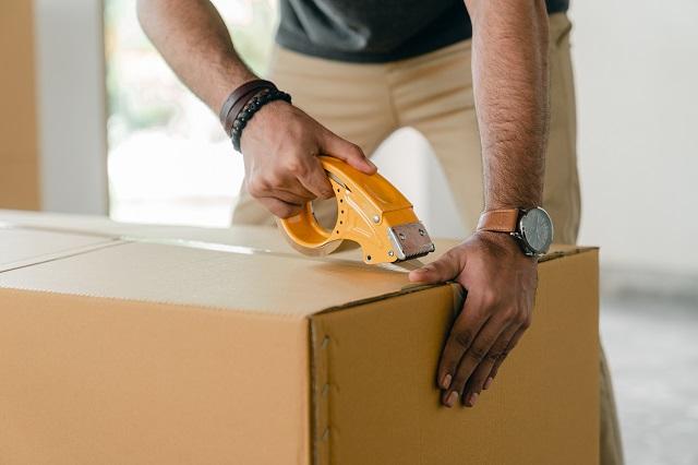 Man packing large box