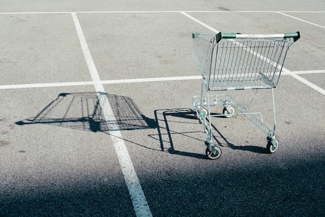 Shopping cart alone in a parking lot