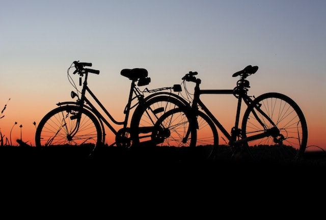 bikes against a sunset at dusk