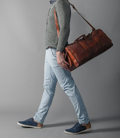 Man Modeling A Leather Bag