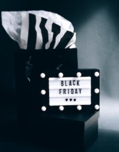 Black Friday sign with gift bag