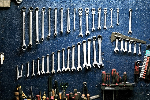 Assorted tools resting on workbench