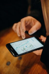 Person checking map on smartphone