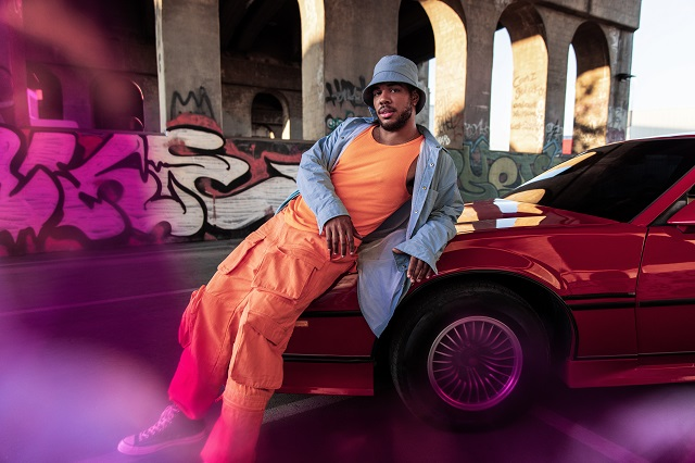 Donté Colley leaning on car