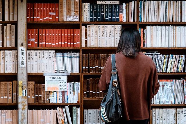 Person browsing books