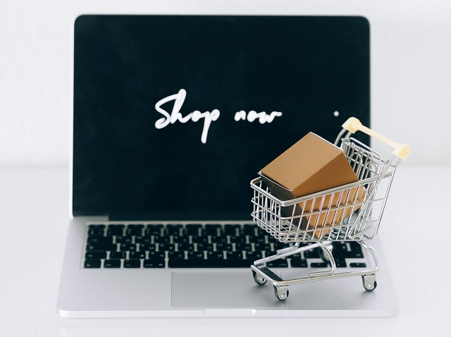 Laptop with shopping cart on keyboard