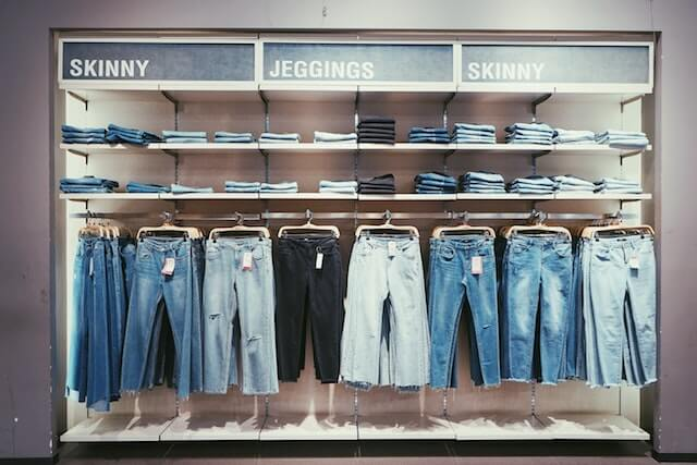 Jeans hanging up in store