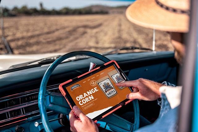 Evan Rocheford viewing Professor Torbert's Orange Corn™ website