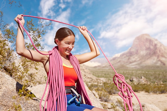 Lizzy VanPatten holding climbing ropes
