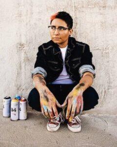 Sara Sandoval with spray paint cans-1