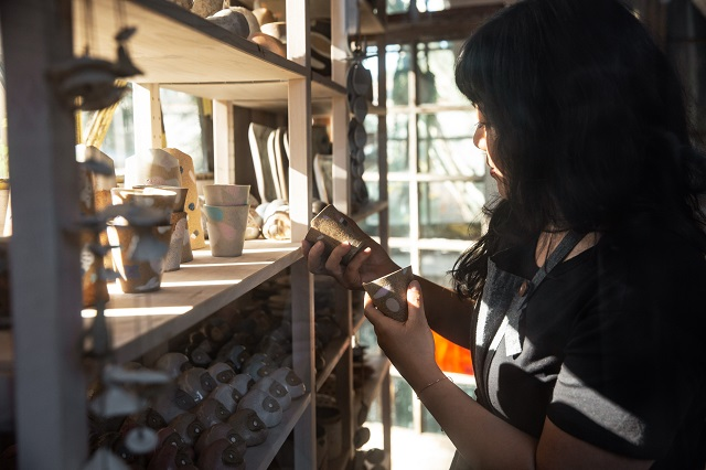 Knotwork LA owner Linda Hsiao looking over her products