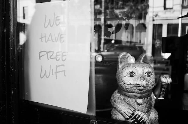 Free Wi-Fi sign with cat statue