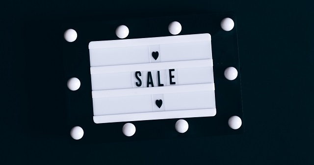 """Black and white letterboard with the word """"Sale"""""""