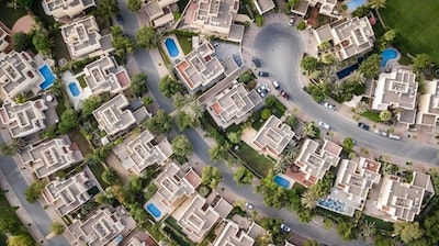 Aerial View of Buildings Illustrates Comparing Real Estate to Domain Names