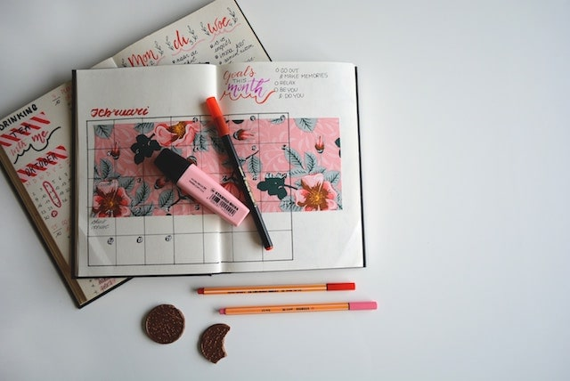 American Work Life Balance Planner with pens on white background