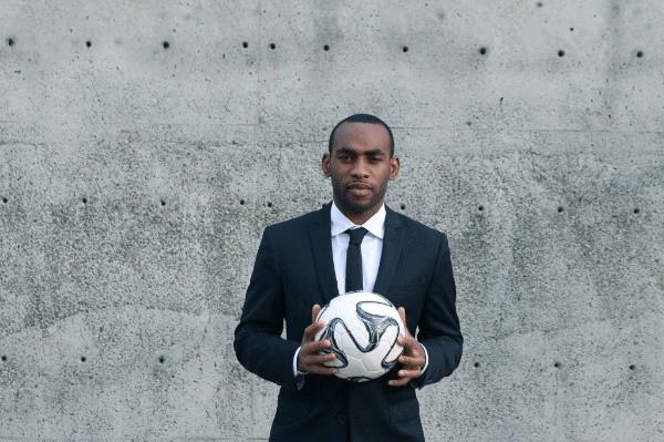 Amobi Okugo Holding Soccer Ball