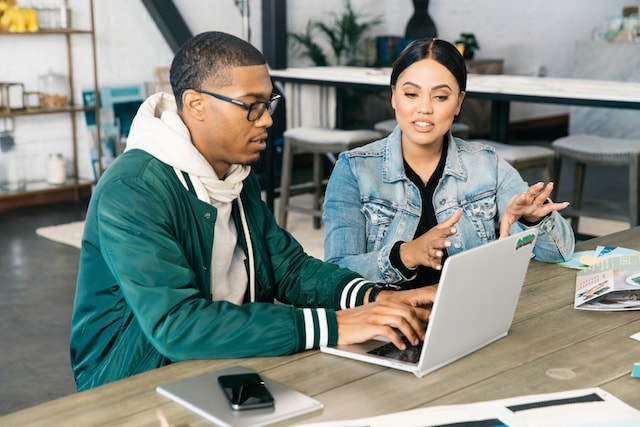 Ayesha Curry with Website Designer at Laptop