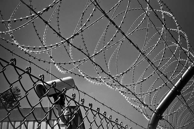 Barb Wire Fence Security Camera Illustrates EPP Code for Domain Security