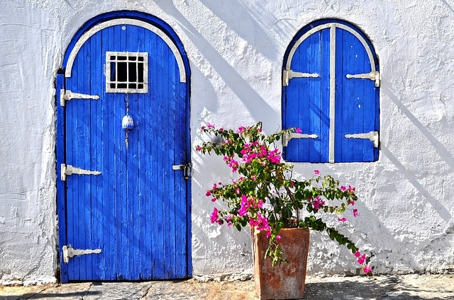 Blue Door Represents Entry Point When Starting Real Estate Business