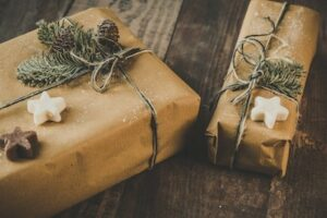 Holiday gifts wrapped in brown paper with stars