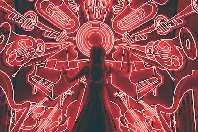 Buying Behavior Women Standing in Front of Red Neon Instruments