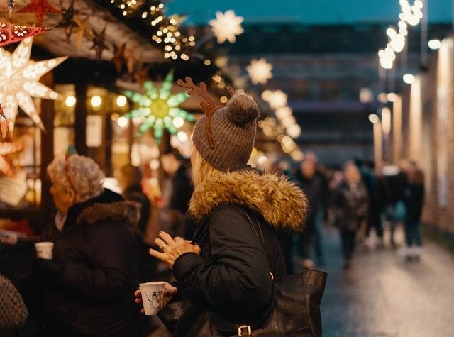 Woman Standing In Winter Market