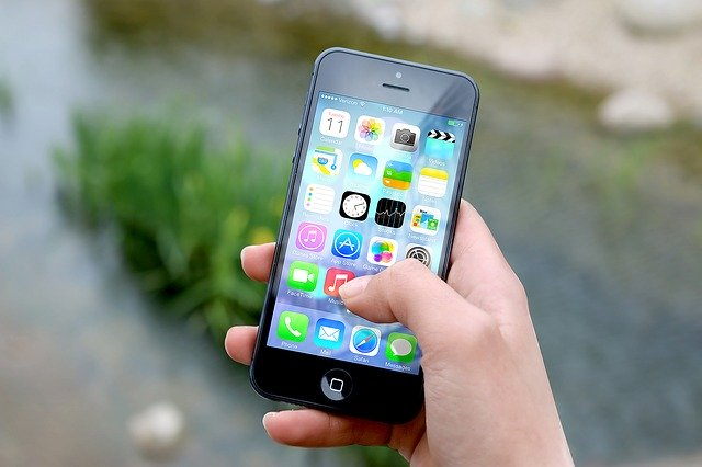 User Holding Mobile Phone Illustrating Communication Preferences