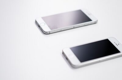 Two Smartphones Resting On A Table