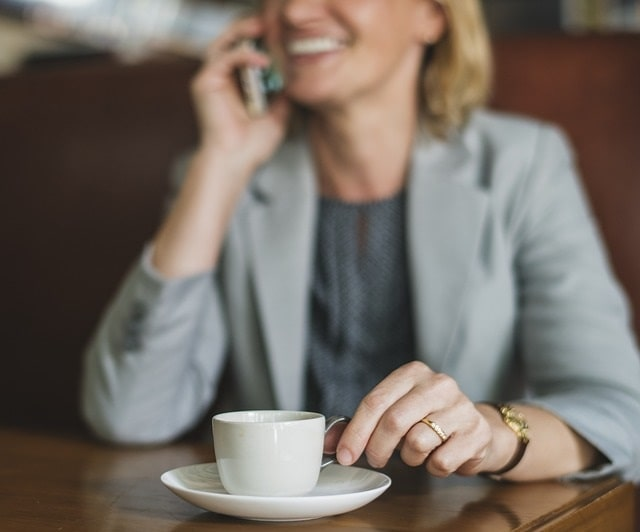 Follow Up With Clients Happy Woman On Phone Drinking Coffee