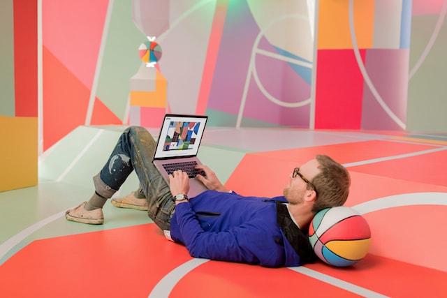 GoDaddy Project Blackboard Dan Peterson Working On His Laptop