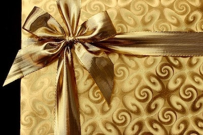 Gold Gift Package Illustrates Holiday Sales