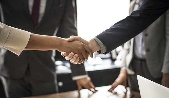 Handshake Illustrates Success Domain Buy with Domain Broker
