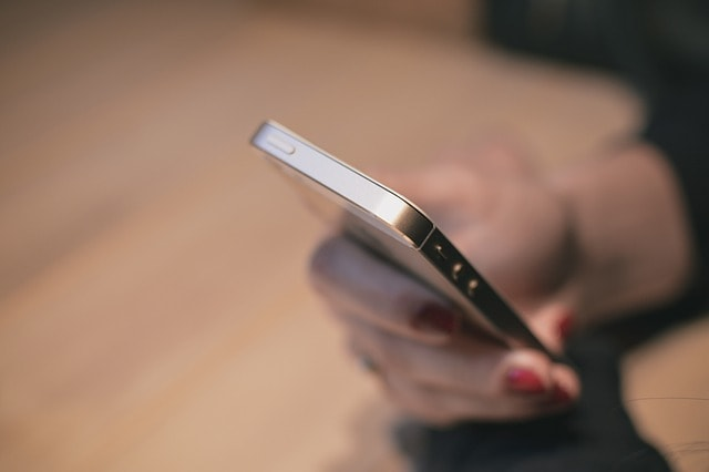 Holding Smartphone to Illustrate Mobile Online Search
