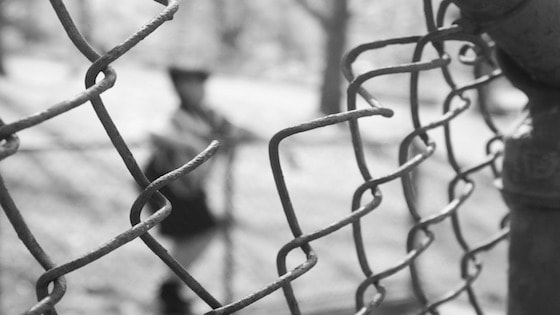 hole-in-fence-represents-online-security-threats
