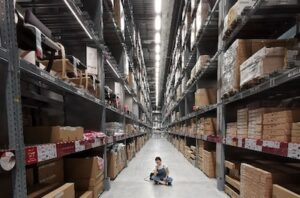 Holiday eCommerce Planning Woman Sitting In Warehouse
