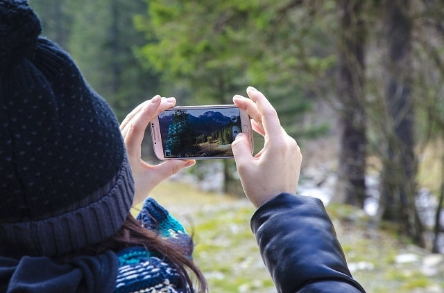 Woman Filming During Winter