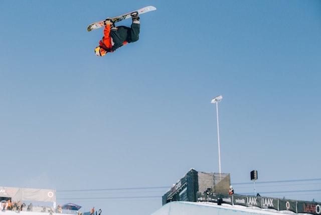 Snowboarder Upside Down on Slopes