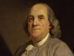 How to File Taxes Ben Franklin Portrait Next to Quote