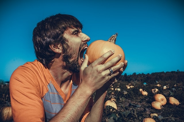 How To Sell A Website To A Client Man Biting Pumpkin